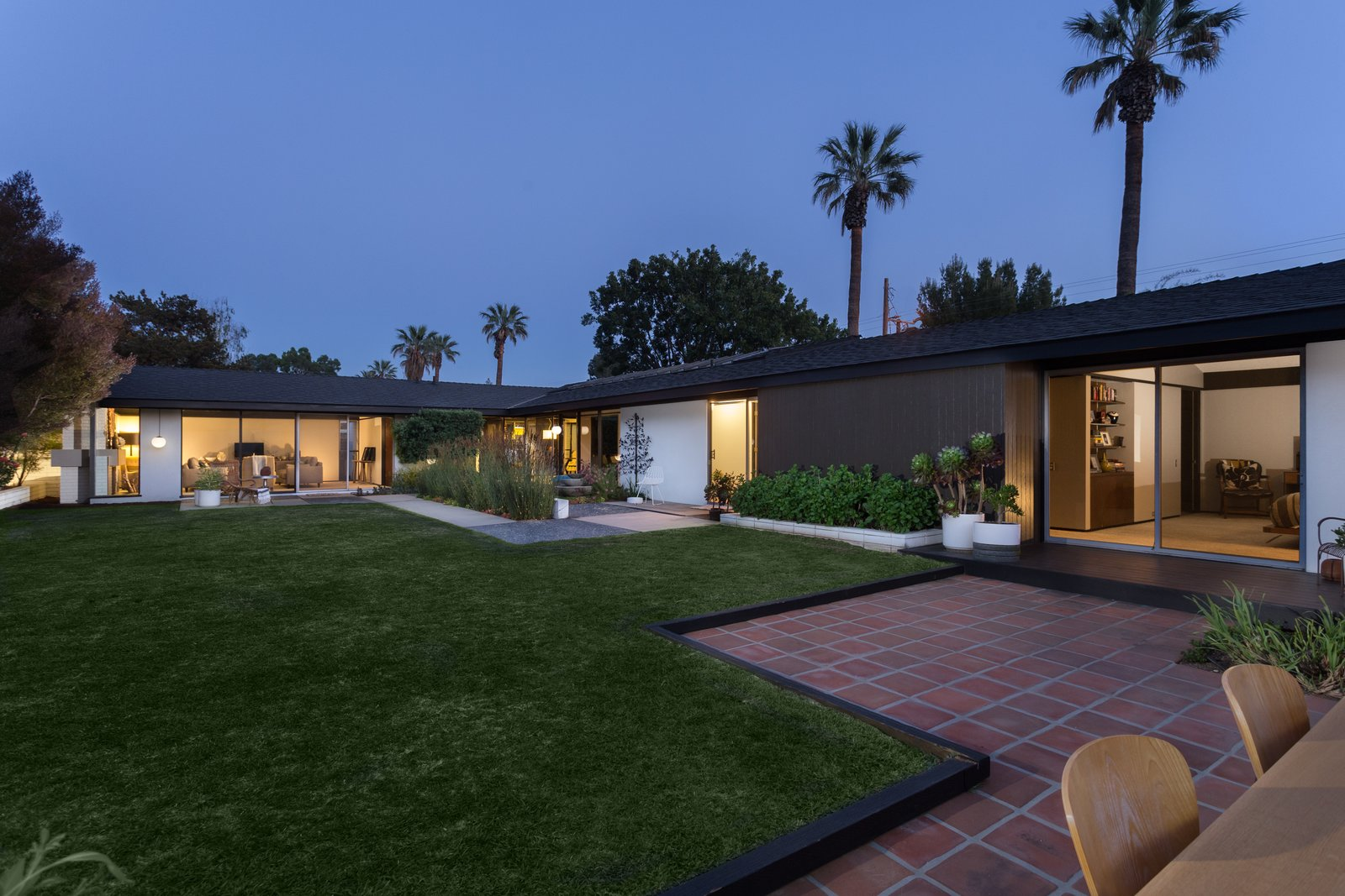 Outdoor, Back Yard, and Grass  Photo 14 of 14 in Offered at $899K, a Restored Midcentury Abode Shines in Southern California