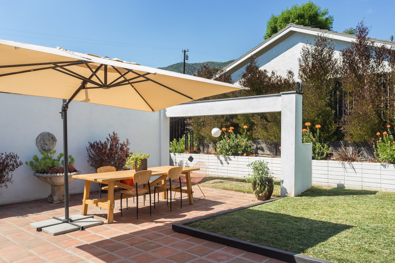 Outdoor, Back Yard, Grass, and Small Patio, Porch, Deck  Photo 12 of 14 in Offered at $899K, a Restored Midcentury Abode Shines in Southern California