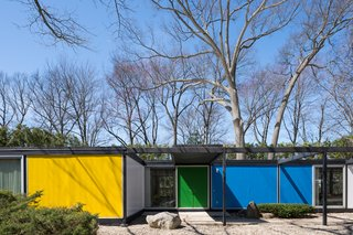 A Rare Midcentury Prefab Looks Just Like it Did in 1958—Down to the Knoll and Paul McCobb Interiors - Photo 1 of 13 - Built with a steel frame, the Frost House features panels of styrofoam between aluminum sheets for the exterior walls and styrofoam between plywood for the roof and floors. Bold, primary colors accentuate its geometric form.