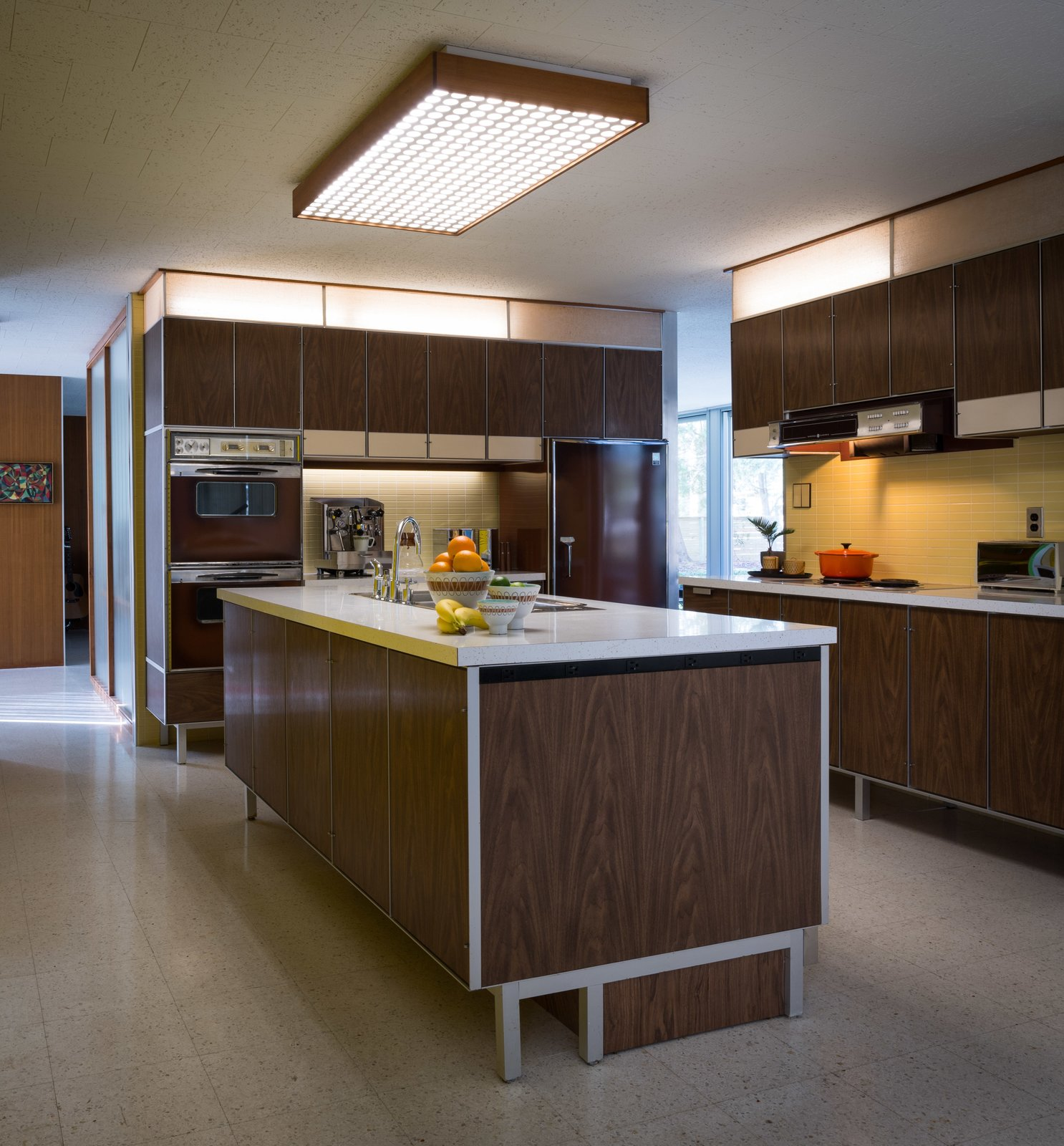 Kitchen, Wall Oven, Refrigerator, and Terrazzo Floor Paul McCobb designed the kitchen, built-in units, and vanities as well.  Photo 6 of 14 in A Rare Midcentury Prefab Looks Just Like it Did in 1958—Down to the Knoll and Paul McCobb Interiors