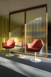 A pair of Saarinen Tulip Armchairs offers front-row seats to an ever-changing view from the bedroom, which benefits from floor-to-ceiling windows.