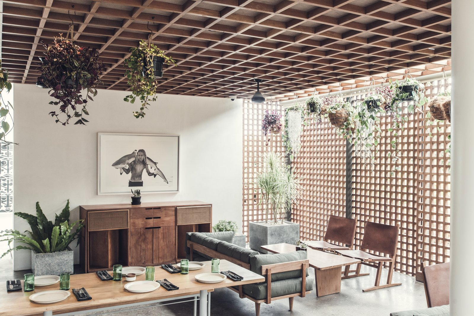Living Room, Console Tables, Ceiling Lighting, Table, Chair, Sofa, Coffee Tables, and Concrete Floor  Best Photos from Go Beyond the Basics in an Australian Fashion Designer's Surf-Inspired Bali Hotel