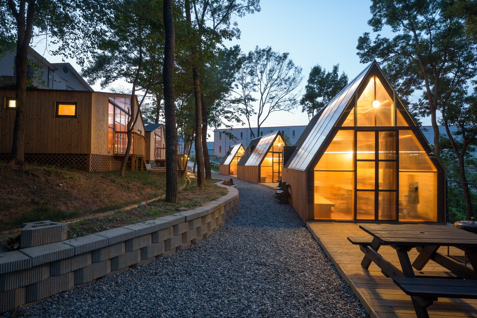 Exterior, Cabin Building Type, Shed Building Type, Gable RoofLine, and Wood Siding Material  Photo 3 of 11 in A Camping Village in South Korea Draws Inspiration From an Iconic Fairy Tale