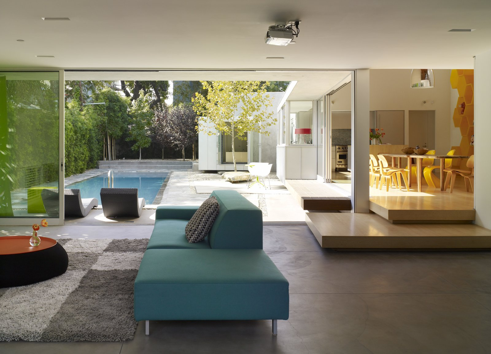 Living Room, Sofa, and Concrete Floor  Photo 2 of 9 in Tobey Maguire Snatches Up Googleplex Architect Clive Wilkinson's Los Angeles Home For $3.4M