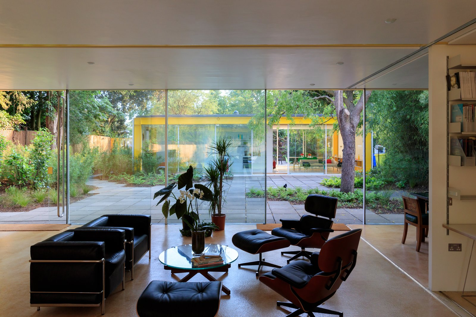 Living Room, Chair, Coffee Tables, and Recliner  Photo 13 of 14 in Fully Renovated, Wimbledon House by Richard Rogers Hosts New Architecture Fellows in London