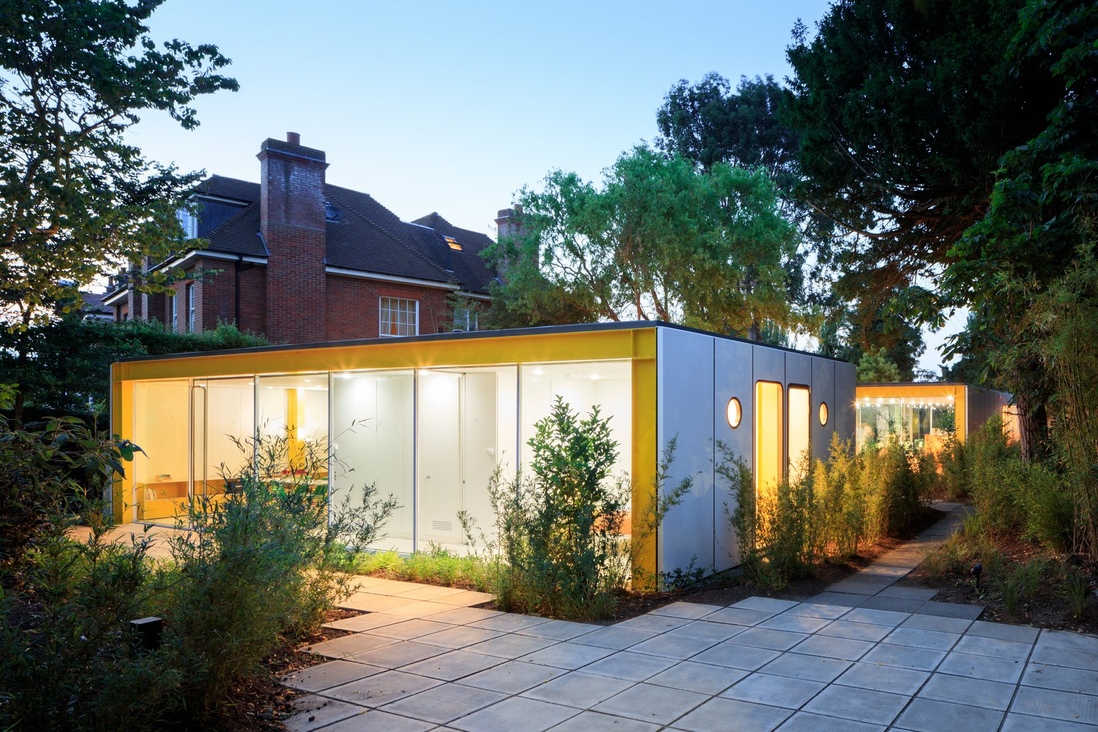 Tagged: Outdoor, Pavers Patio, Porch, Deck, Large Patio, Porch, Deck, and Back Yard.  Photo 6 of 14 in Fully Renovated, Wimbledon House by Richard Rogers Hosts New Architecture Fellows in London