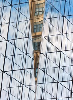 """Read Between the Facades. """"A modern glass and concrete building with a mirrored facade detail, quoting like a good architectural neighbor the building across the street,"""" says Olic."""
