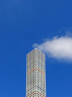 The Smoking Building. A well-placed cloud gives the impression that this New York City building is emitting steam, a visual metaphor for the hot real estate market.