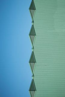 """The Blue Green Mile. """"Warmed by the unobstructed afternoon sun, individual parts of the large Art Deco collection at the Fair Park Complex in South Dallas come to more attention,"""" says Olic."""