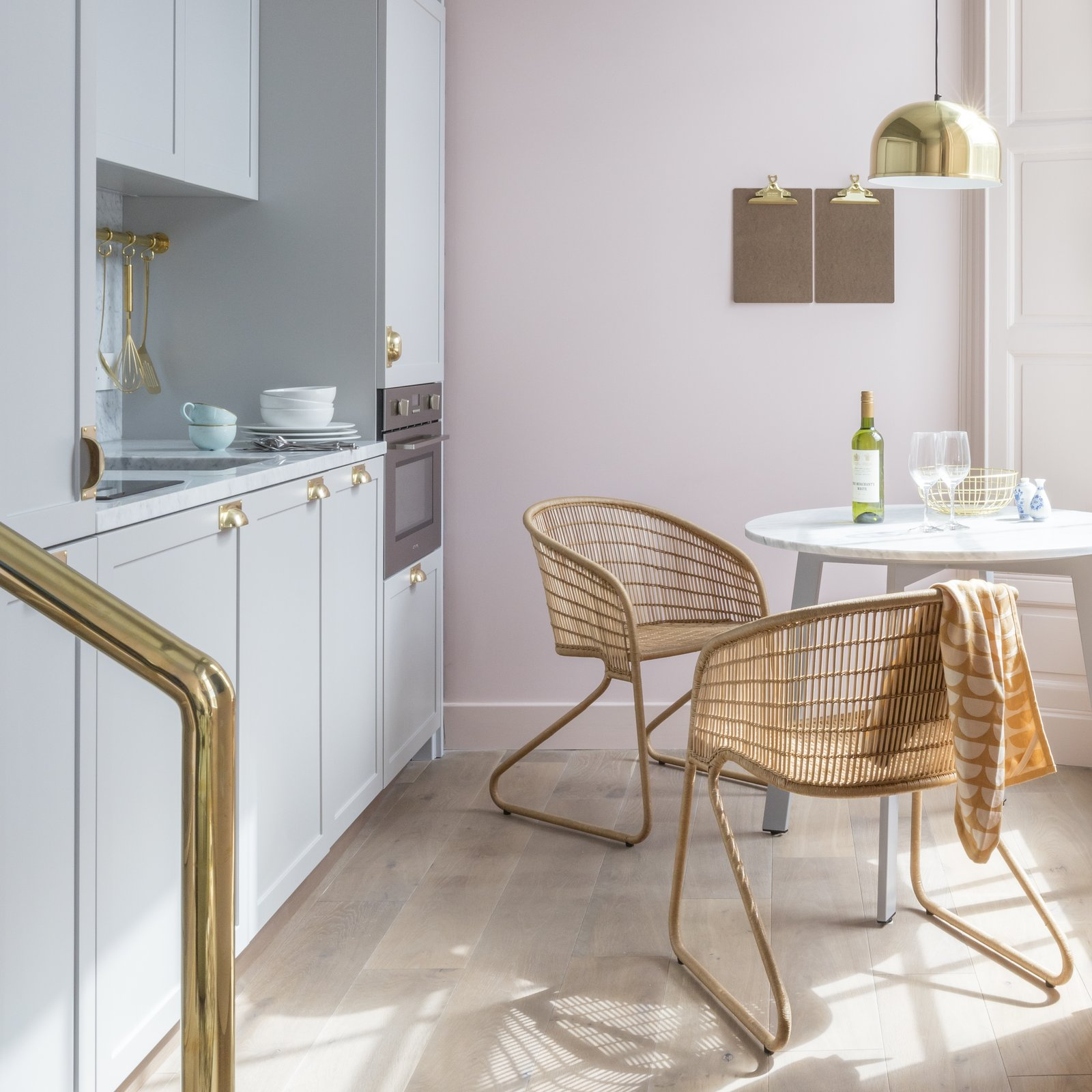 Kitchen, Marble Counter, Medium Hardwood Floor, Colorful Cabinet, and Pendant Lighting  Photo 7 of 12 in Part Apartment, Part Boutique Hotel, Eden Locke Brings a New Brand of Comfort to Edinburgh