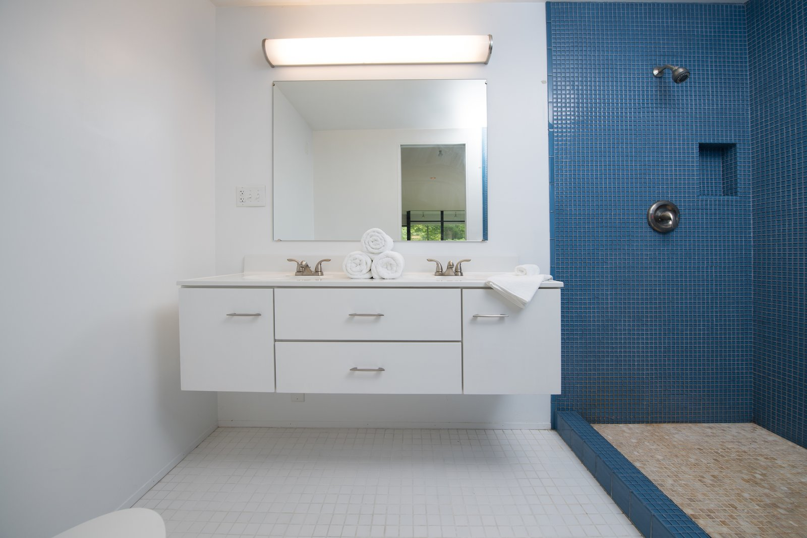 Bath Room, Open Shower, Mosaic Tile Wall, and Wall Mount Sink  Photo 9 of 12 in At $265K, Michael Graves's First Commission Is a Bargain