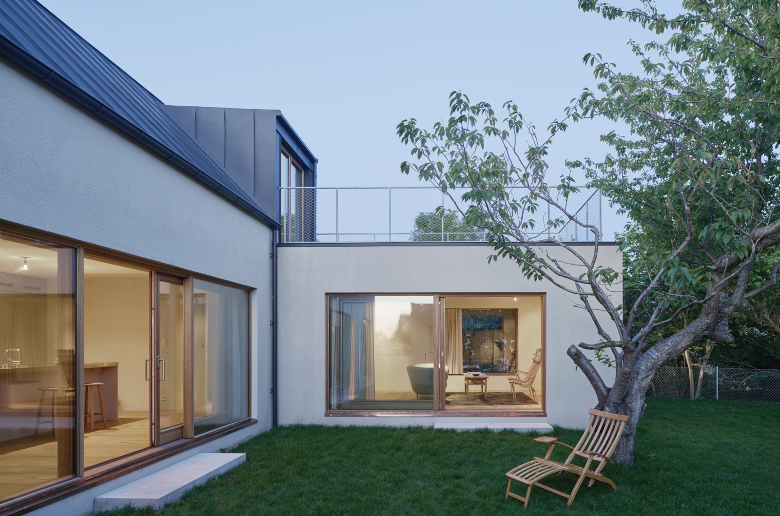 Outdoor, Back Yard, Trees, and Grass  Photo 10 of 12 in Sleek Scandinavian Design Permeates a Family's Summer House in an Old Fishing Village