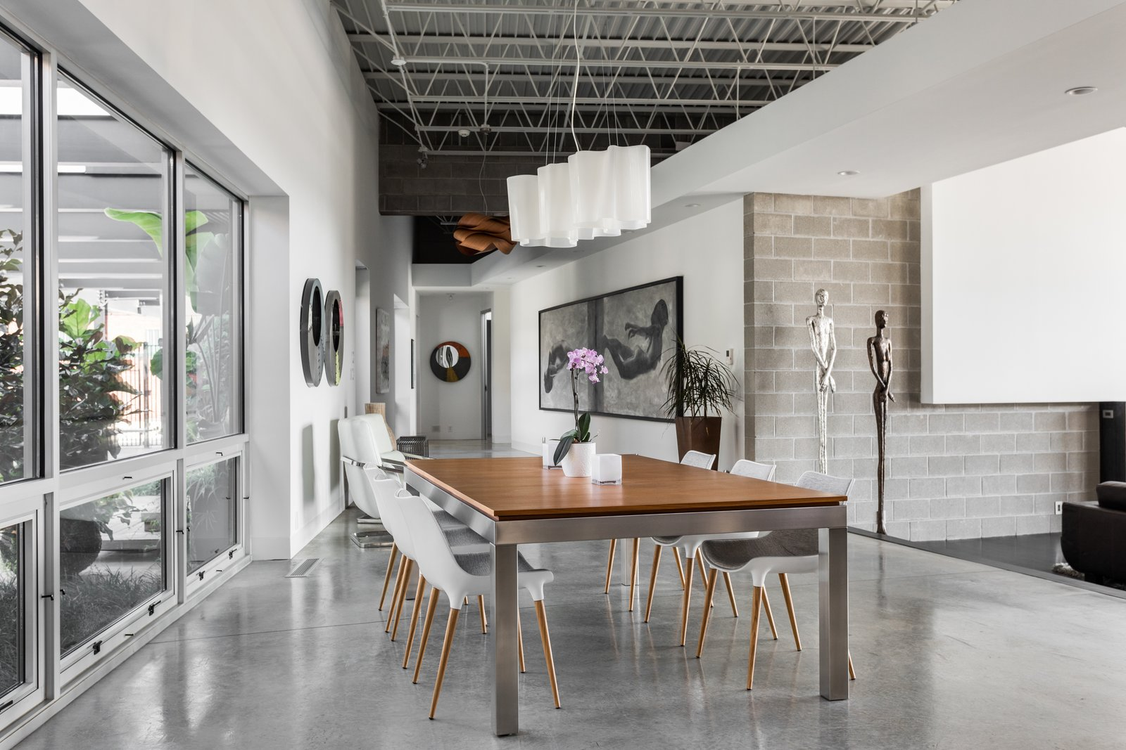 Dining Room, Table, Chair, Accent Lighting, and Concrete Floor  Photo 5 of 12 in A Converted Ink Factory in Downtown Indianapolis Asks $2.6M
