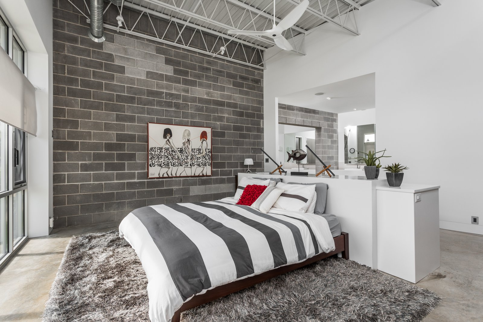 Bedroom, Bed, and Concrete Floor  Best Photos from A Converted Ink Factory in Downtown Indianapolis Asks $2.6M