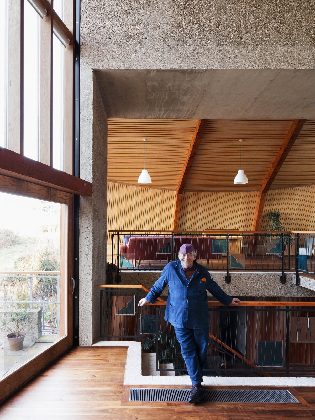 Living Room, Dark Hardwood Floor, and Pendant Lighting  The Boathouse from Resembling the Inverted Hull of a Ship, an English Guest House Pays Homage to the Harbor