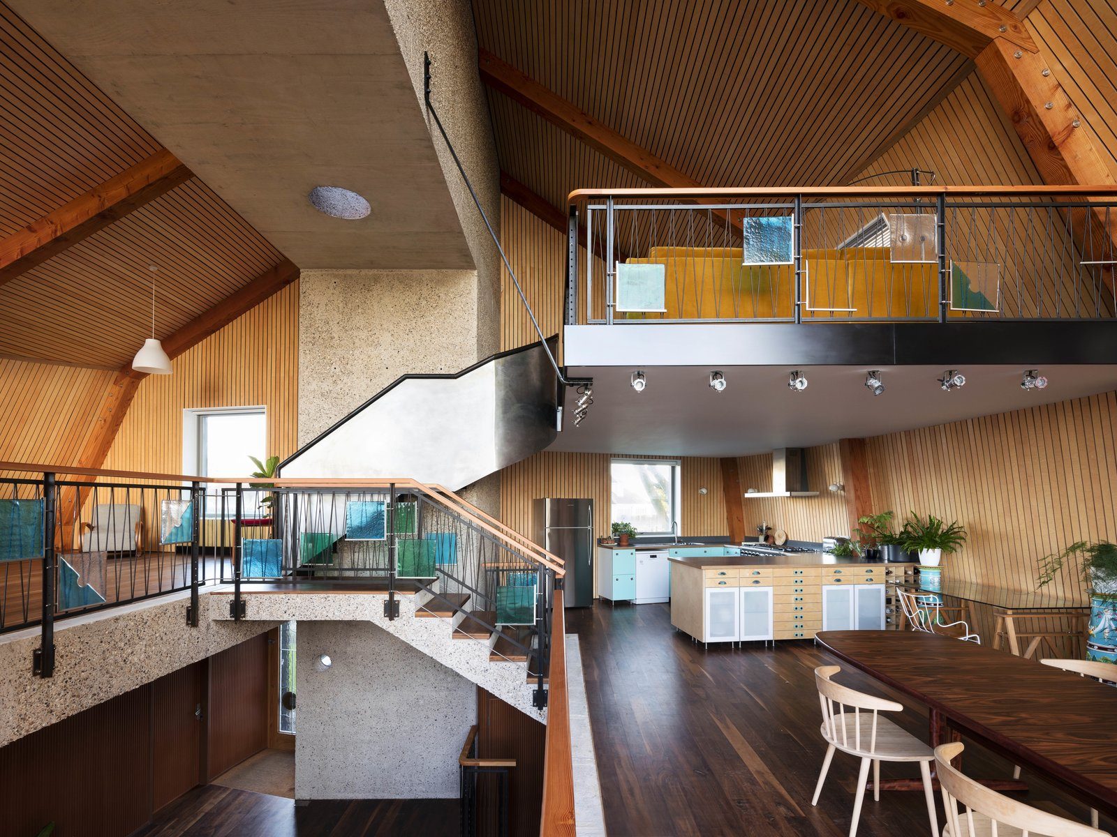 Dining Room, Table, Dark Hardwood Floor, and Chair  The Boathouse from Resembling the Inverted Hull of a Ship, an English Guest House Pays Homage to the Harbor