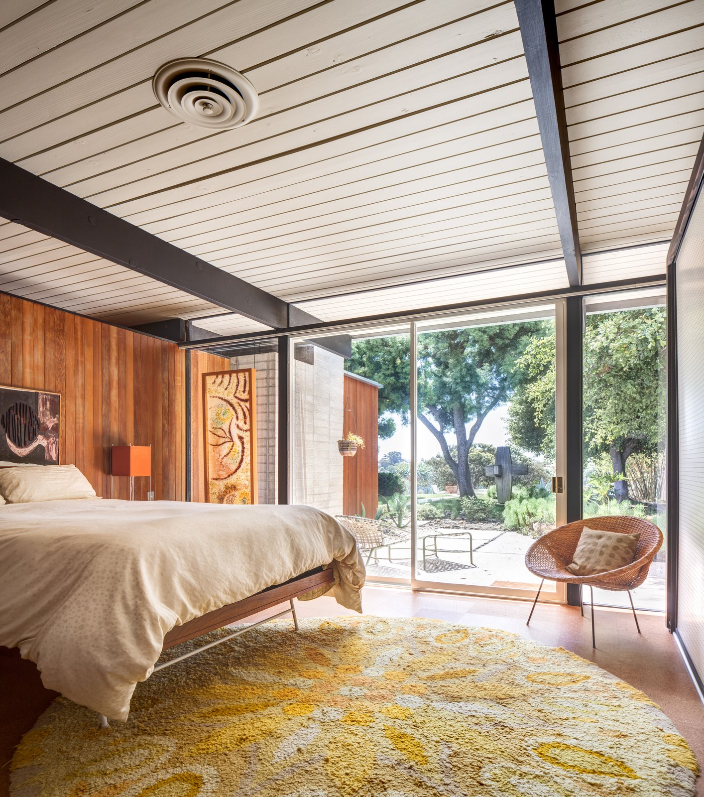 Bedroom, Bed, Table Lighting, Chair, and Cork Floor  Photo 7 of 10 in A Stunningly Restored Midcentury by Case Study Architect Craig Ellwood Asks $800K in San Diego