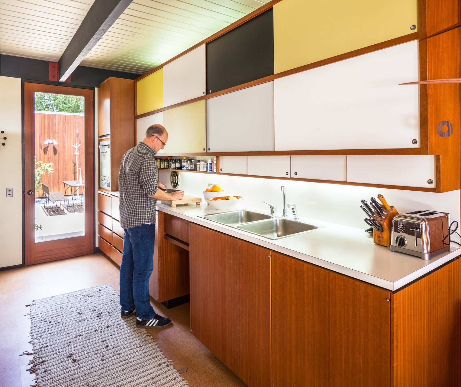 Kitchen, Colorful Cabinet, Cork Floor, and Drop In Sink  Photo 5 of 10 in A Stunningly Restored Midcentury by Case Study Architect Craig Ellwood Asks $800K in San Diego