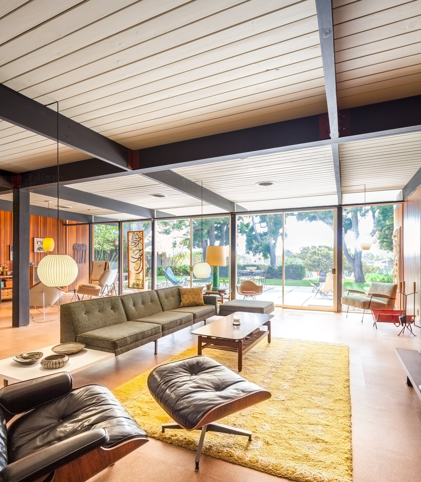 Living Room, Sofa, End Tables, Coffee Tables, Pendant Lighting, and Cork Floor  Photo 3 of 10 in A Stunningly Restored Midcentury by Case Study Architect Craig Ellwood Asks $800K in San Diego