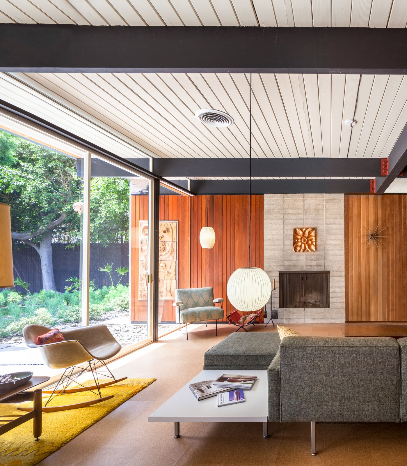 Living Room, Sofa, End Tables, Chair, Pendant Lighting, Cork Floor, and Standard Layout Fireplace  Best Photos from A Stunningly Restored Midcentury by Case Study Architect Craig Ellwood Asks $800K in San Diego