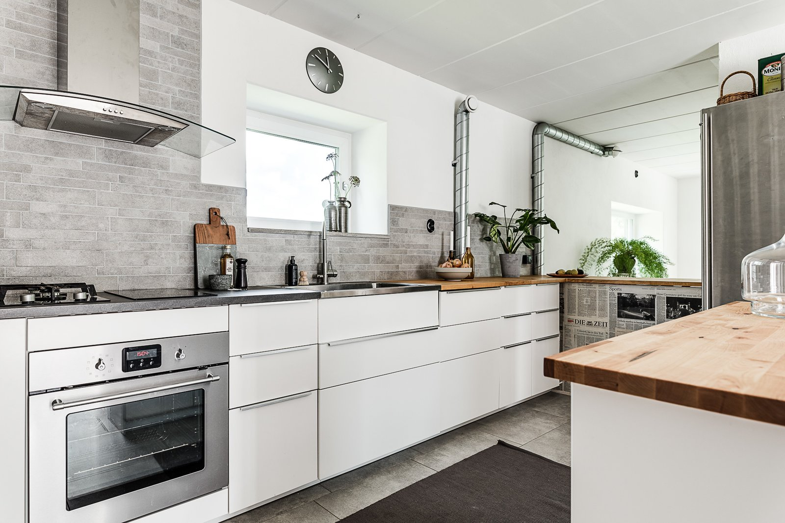 Kitchen, White Cabinet, Wood Counter, Refrigerator, Stone Tile Backsplashe, Range, and Drop In Sink  Photo 5 of 12 in Make This Enchanting Swedish Greenhouse Your Home For $864K