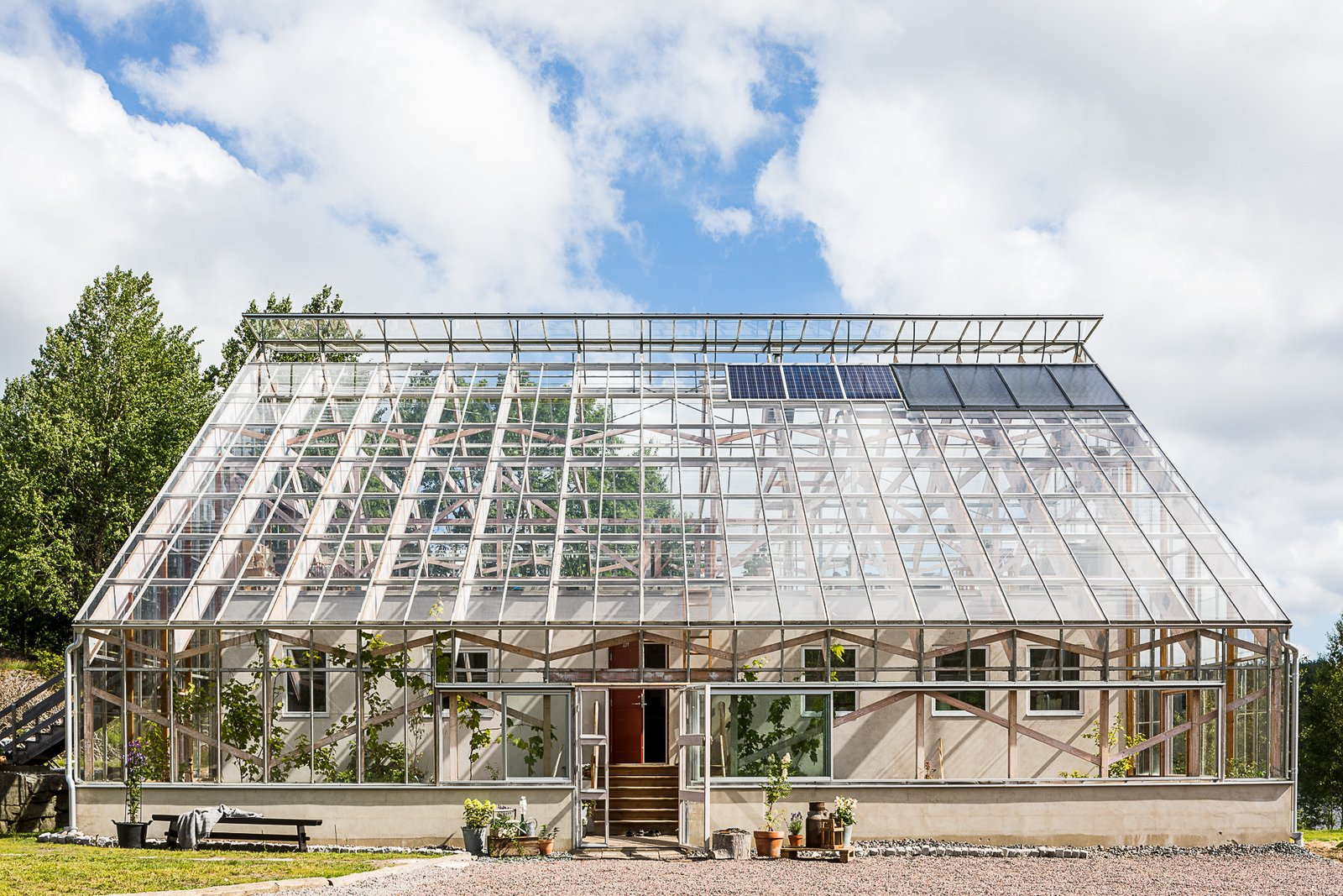 Outdoor, Front Yard, and Grass  Photo 1 of 12 in Make This Enchanting Swedish Greenhouse Your Home For $864K