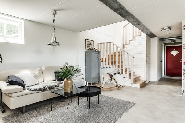 Living Room, Coffee Tables, Concrete Floor, Sofa, and Pendant Lighting  Havredalsvägen 239 from Make This Enchanting Swedish Greenhouse Your Home For $864K