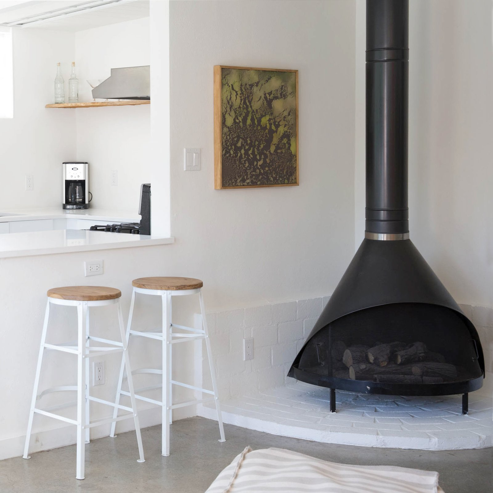 The Amado wood burning fireplace in corner of the living area.