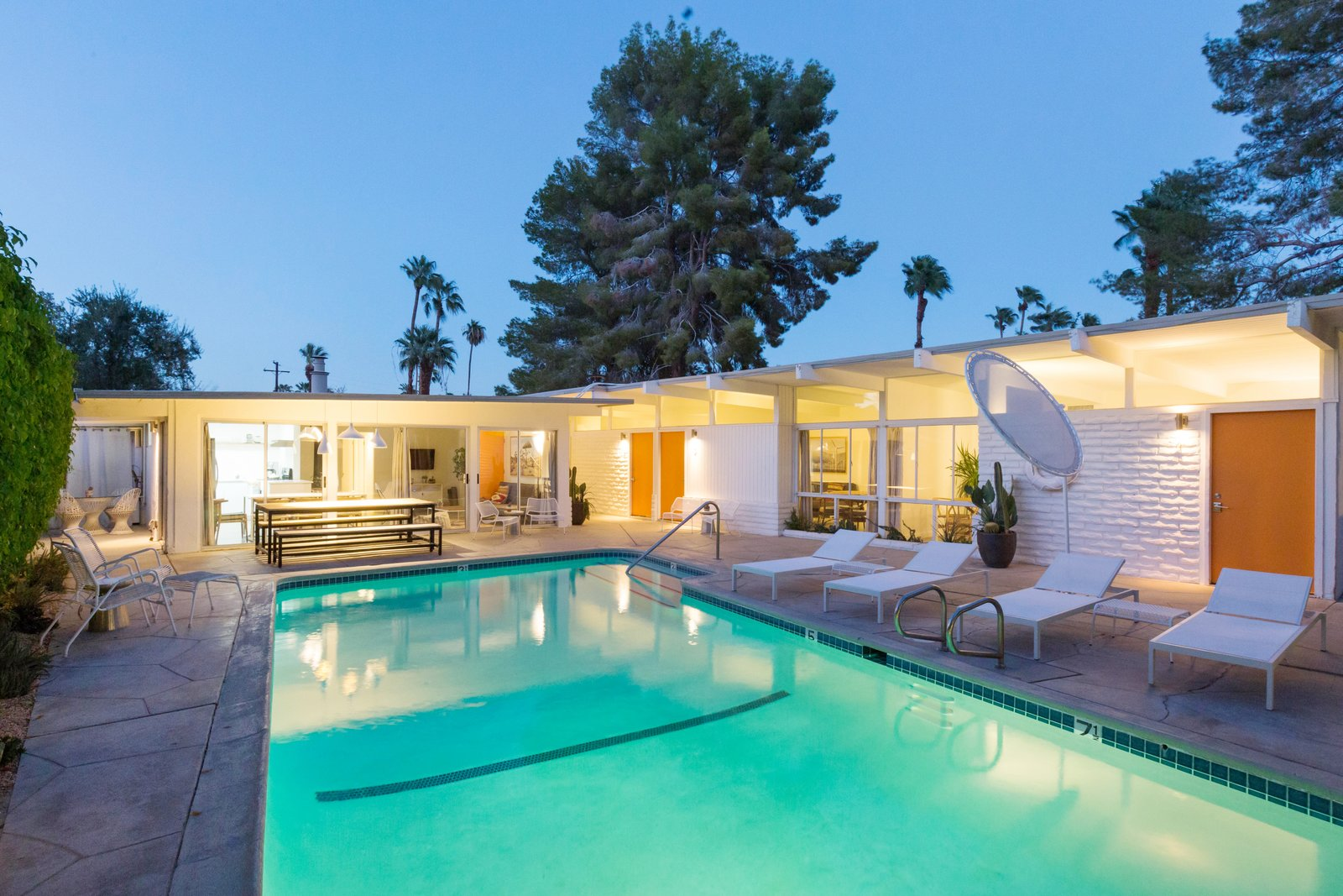 Outdoor, Trees, Concrete Patio, Porch, Deck, Swimming Pools, Tubs, Shower, Large Pools, Tubs, Shower, and Large Patio, Porch, Deck  Photo 11 of 12 in A Celebrated Palm Springs Hotel Asks $1.8M
