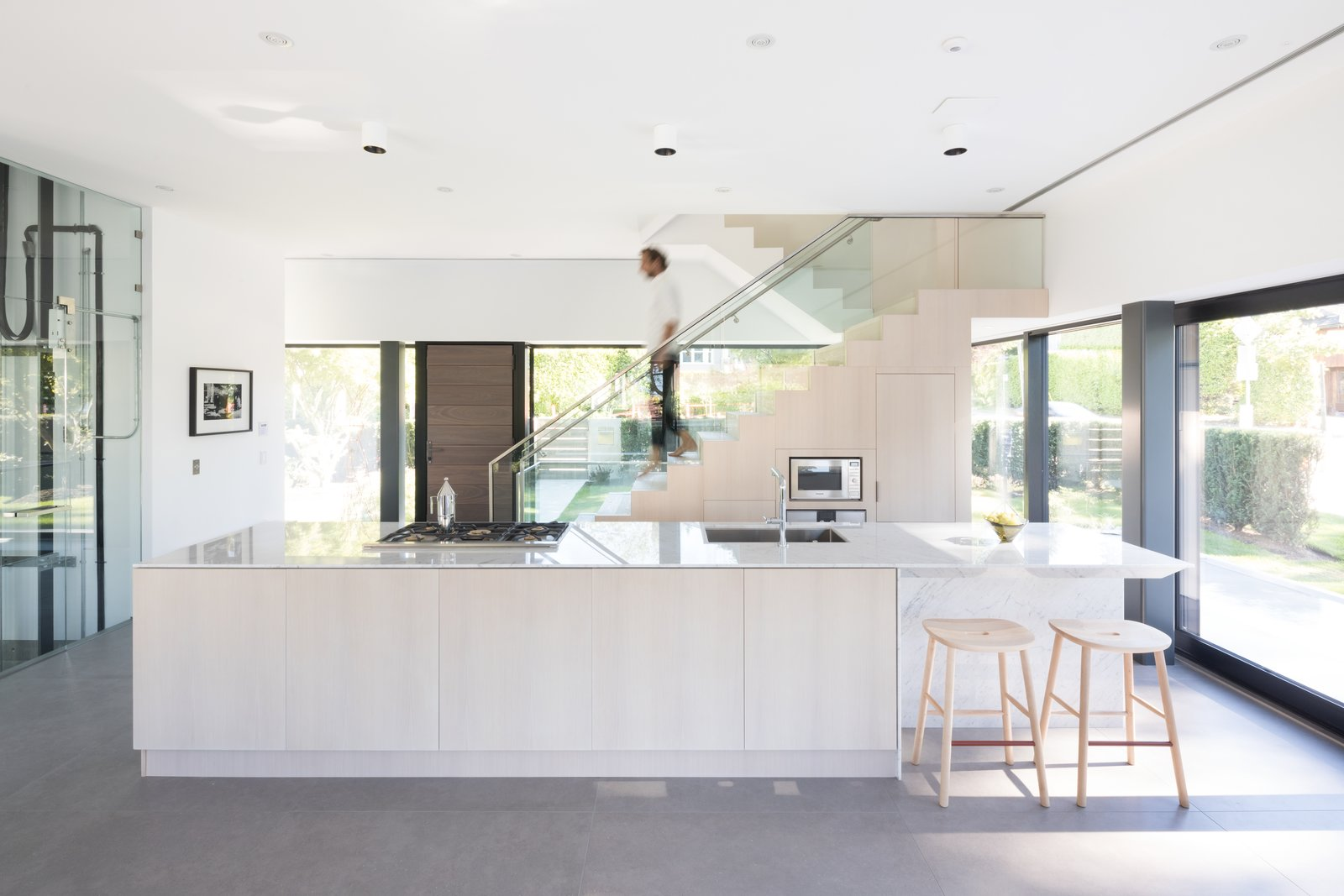 Kitchen, Wood Cabinet, Marble Counter, Range, Undermount Sink, Microwave, and Recessed Lighting  Photo 5 of 12 in Wrapped in Galvanized Steel, 'Cube House' in Vancouver Asks $12.8M