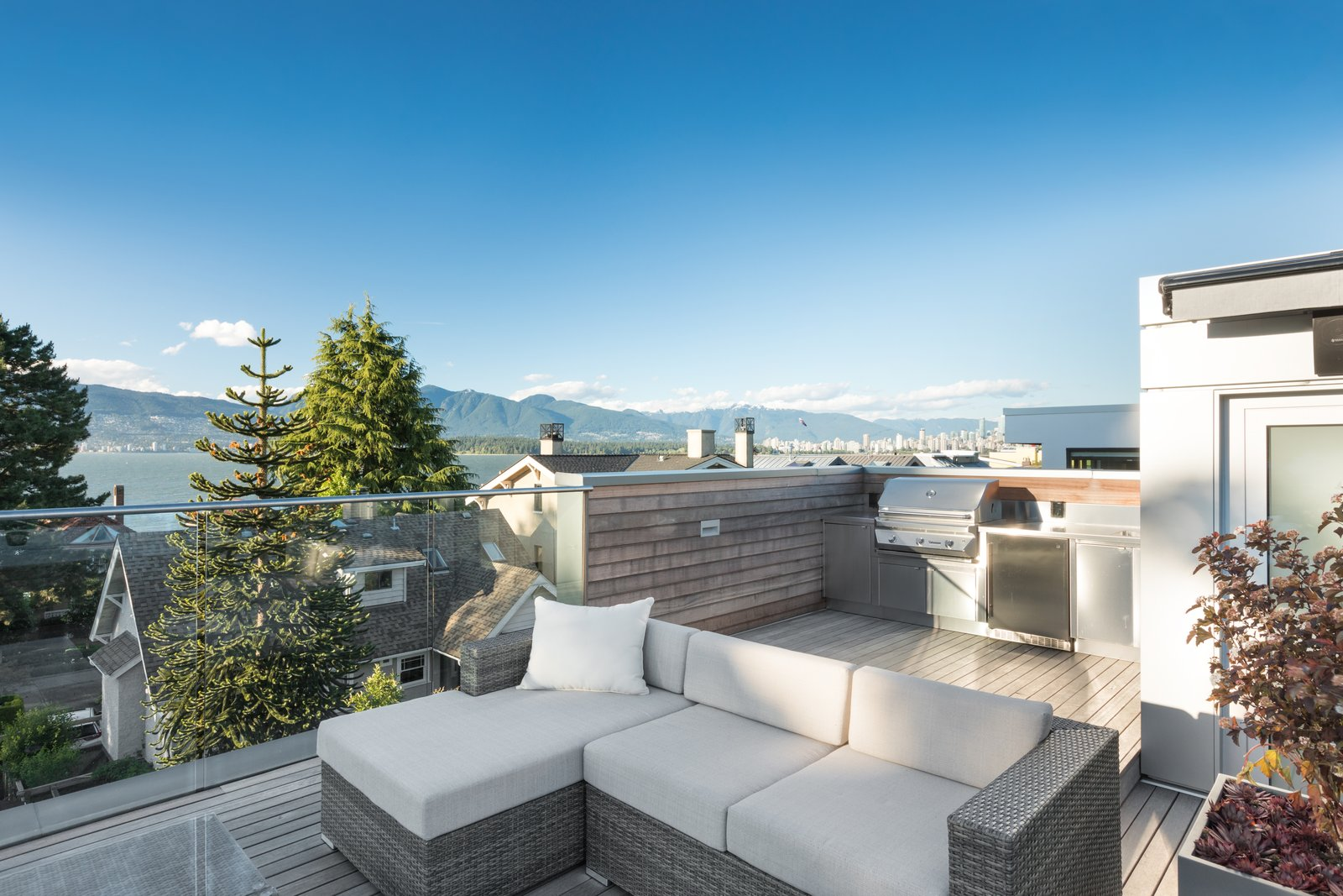 Outdoor, Wood Patio, Porch, Deck, and Raised Planters  Photo 10 of 12 in Wrapped in Galvanized Steel, 'Cube House' in Vancouver Asks $12.8M