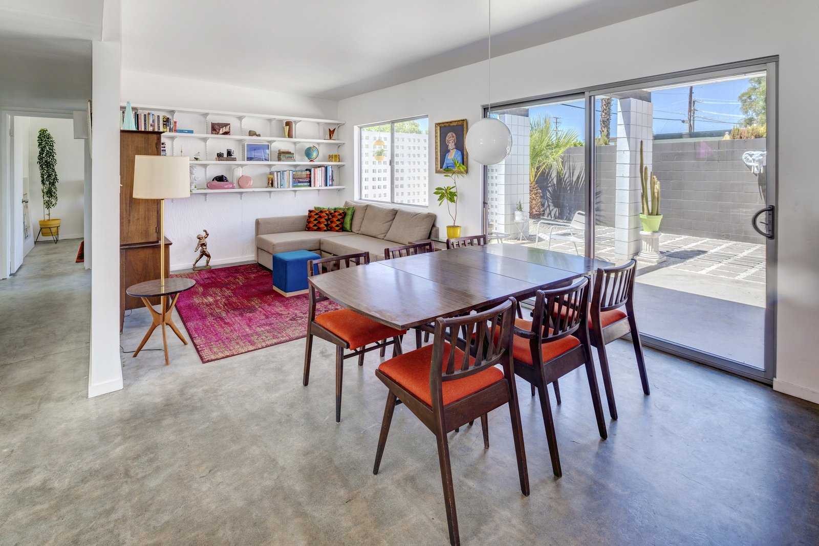 Dining, Concrete, Pendant, Chair, Table, Shelves, and Lamps  Dining Concrete Table Shelves Lamps Chair Photos from A Donald Wexler-Designed Midcentury Home in Palm Springs Asks $599K