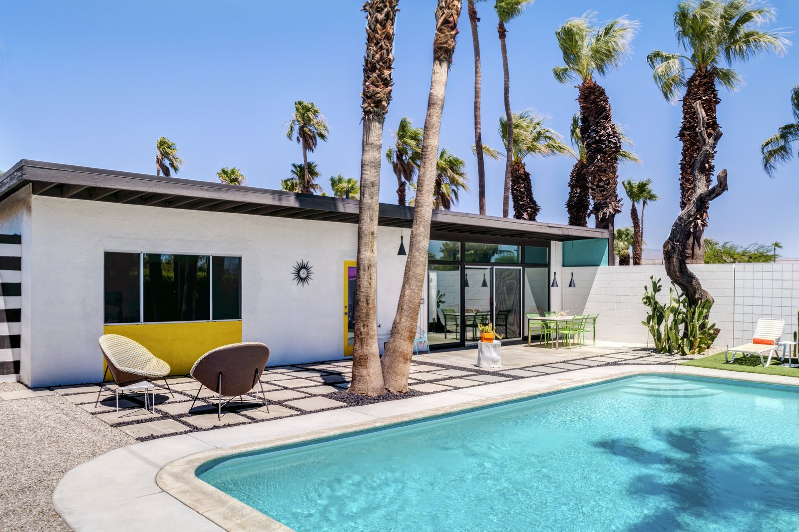 Outdoor, Swimming Pools, Tubs, Shower, Walkways, Hardscapes, Concrete Patio, Porch, Deck, and Large Pools, Tubs, Shower  Photo 10 of 11 in A Donald Wexler-Designed Midcentury Home in Palm Springs Asks $599K