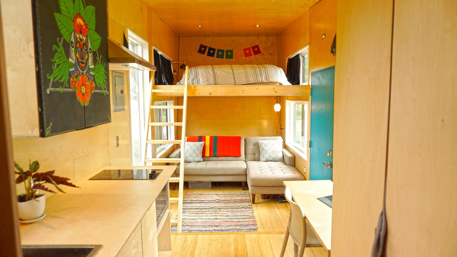 Living Room, Sectional, Desk, Chair, Recessed Lighting, Light Hardwood Floor, and Rug Floor  Photo 11 of 21 in 10 Things You Should Know Before Moving Into a Tiny Home from Go Exploring With This Tiny Home in Tow