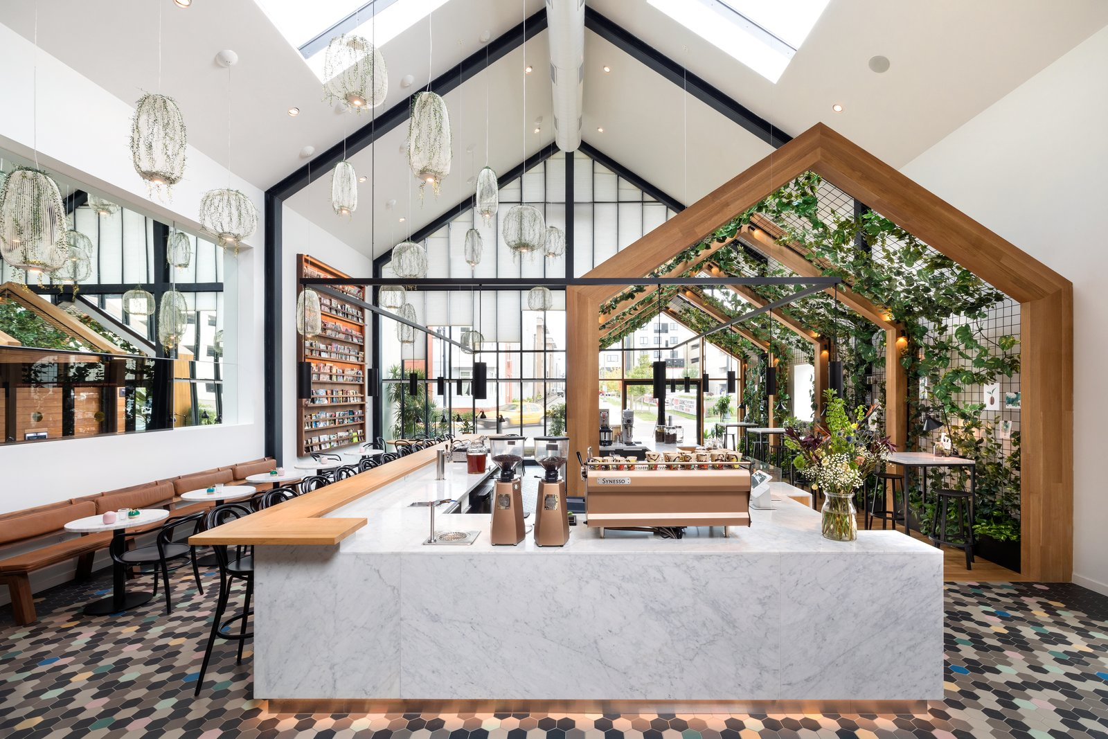 Boutique Coffee Roaster Coperaco's First Cafe Holds a Modern Tree House