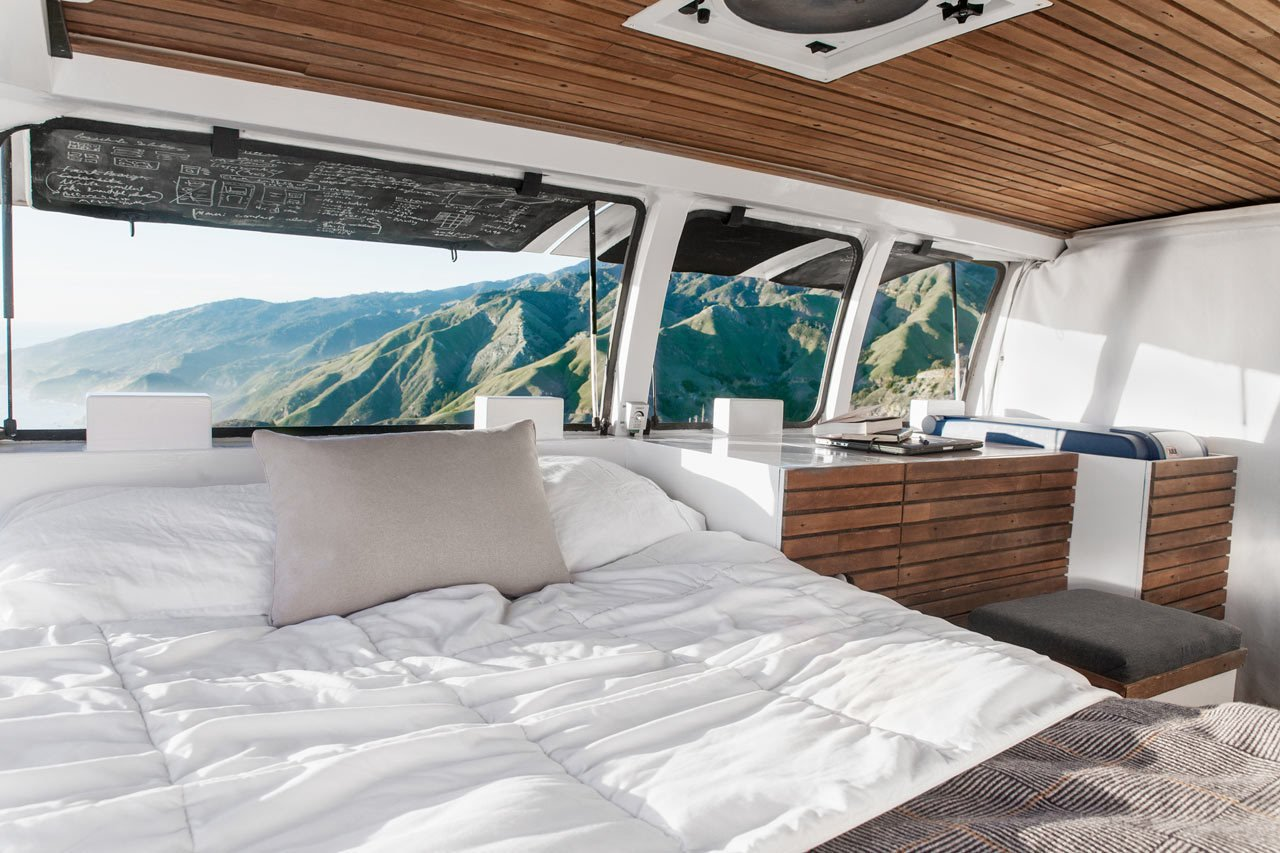 Cargo Van Mobile Studio bedroom with repurposed wood accents