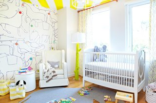 The clients didn't know the sex of the baby so they chose decor that would work for either while still keeping it bright and colorful. One of the walls is covered with a Minikani Lab mural that sets the tone for the room.<br><br>Photo by Jacob Snavely
