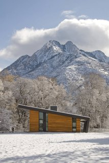 Pasture Project is built on a pasture in the shadows of Mt. Olympus in Holladay, Utah by Imbue Design. With a focus on using minimal energy, the home's living space is situated with a north/south orientation to aid in winter heat gain and summer protection.