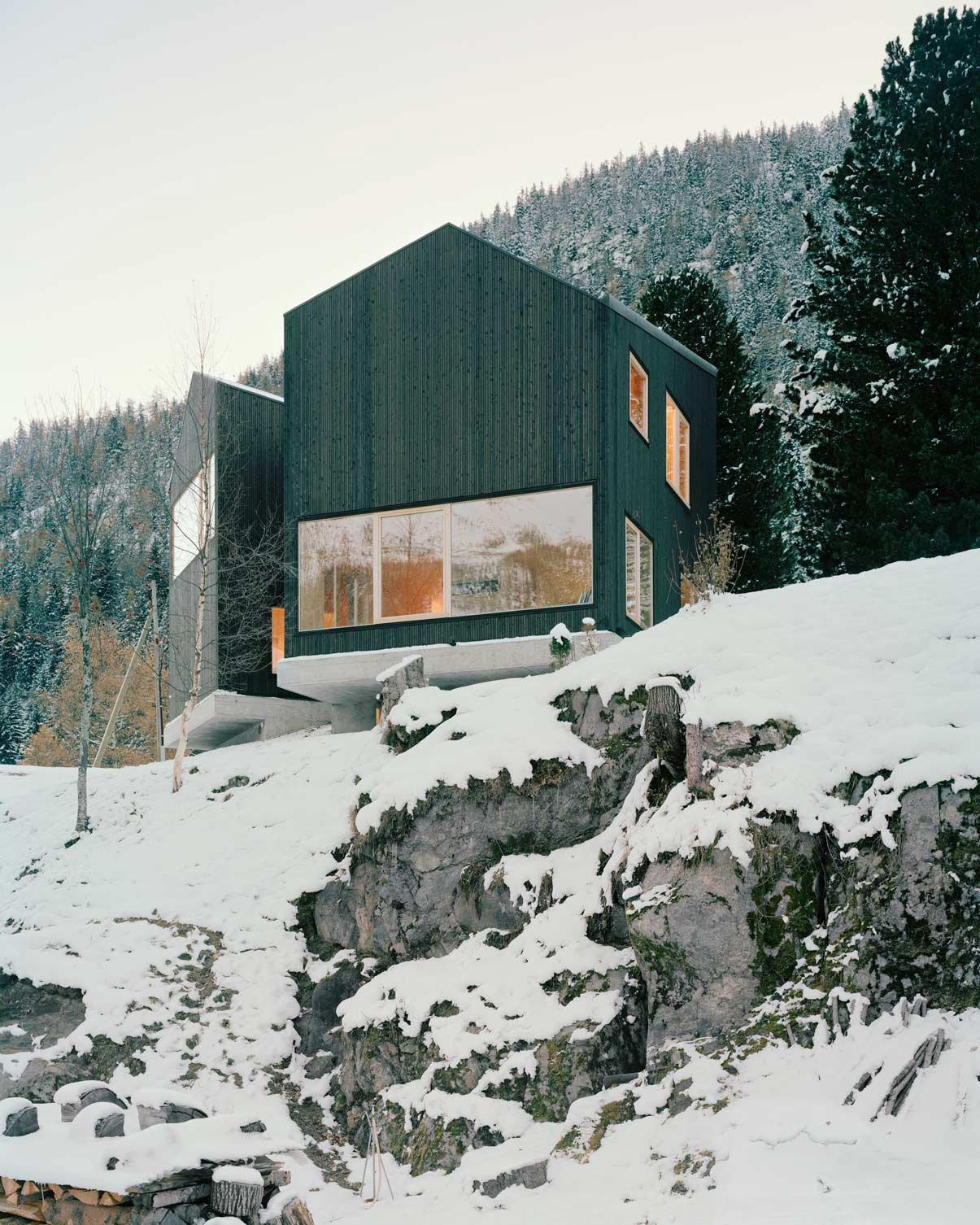 Exterior, Cabin Building Type, House Building Type, and Wood Siding Material Lacroix Chessex Architectes realized La Maison aux Jeurs, a cabin in Les Jeurs, Switzerland situated on a rocky hill above the road. The structure is divided into two volumes that are angled 45 degrees apart with a connection on the mountain side. Both volumes are designed with different views of the valley below.  Photo 11 of 11 in 10 Modern Wintry Cabins We'd Be Happy to Hole Up In