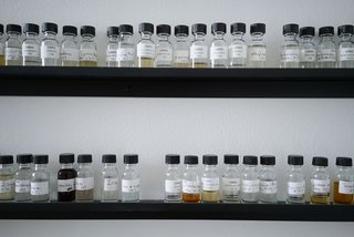 Dozens of essential oils line the walls of the in-house lab