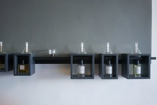 Glass funnels housing test strips lets you smell the essence of the fragrances after it dries