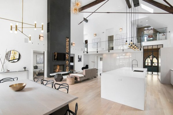 An old church in Chicago, Illinois was handed over to Linc Thelen Design and Scrafano Architects to be converted into a modern home for a family with three young children. The 25-foot ceilings, white surfaces, and wood floors make the space feel grand without being overwhelming or overdone.  Photo 3 of 10 in Traditional Churches Become Modern Homes