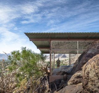 The Frey House II was built in 1964 by architect Albert Frey with mostly glass walls that frame the surrounding rocky landscape. The house even incorporates the massive rocks inside where many would have excavated the material or chosen not to have built there.