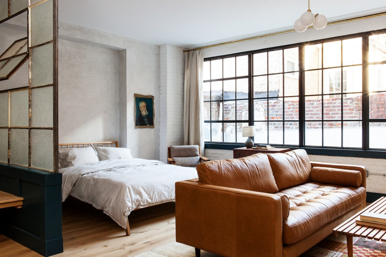 Bedroom, Bed, Pendant Lighting, Chair, and Light Hardwood Floor Each room features a curated collection of art and books.  Photo 8 of 18 in Lokal: A Classic Hotel with a Modern Invisible Service