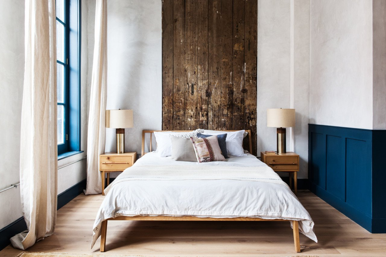 """Bedroom, Bed, Light Hardwood Floor, Night Stands, and Lamps One of the bedrooms, nicknamed """"Billy"""" after William Penn, is a second-floor studio apartment that overlooks the boutique shops of 3rd Street.  Photo 2 of 18 in Lokal: A Classic Hotel with a Modern Invisible Service"""