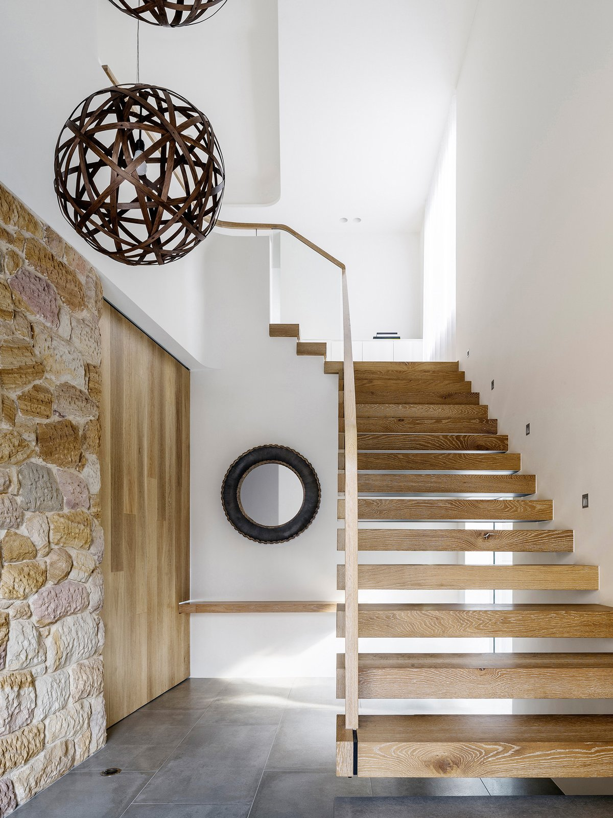 Staircase, Wood Tread, and Wood Railing  Photo 1 of 5 in Top 5 Homes of the Week With Sublime Staircases from Sticks & Stones Home