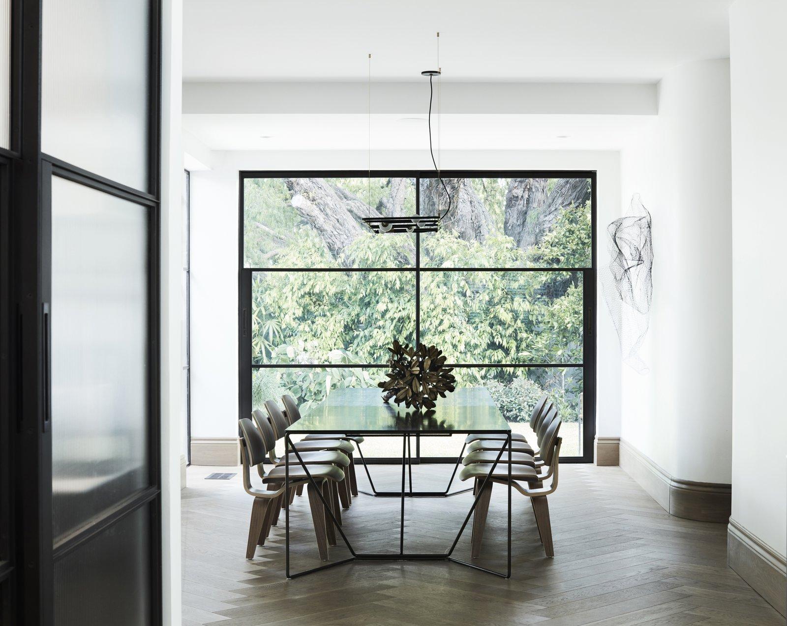 Dining Room, Table Lighting, Pendant Lighting, Ceiling Lighting, Table, Medium Hardwood Floor, and Chair  Best Photos from Peppertree Villa