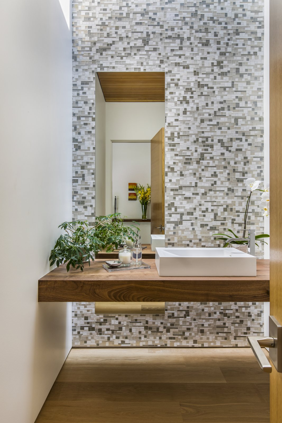 Bath Room, Mosaic Tile Wall, Light Hardwood Floor, Vessel Sink, Wood Counter, and Recessed Lighting  Wildwood by Giulietti / Schouten AIA Architects