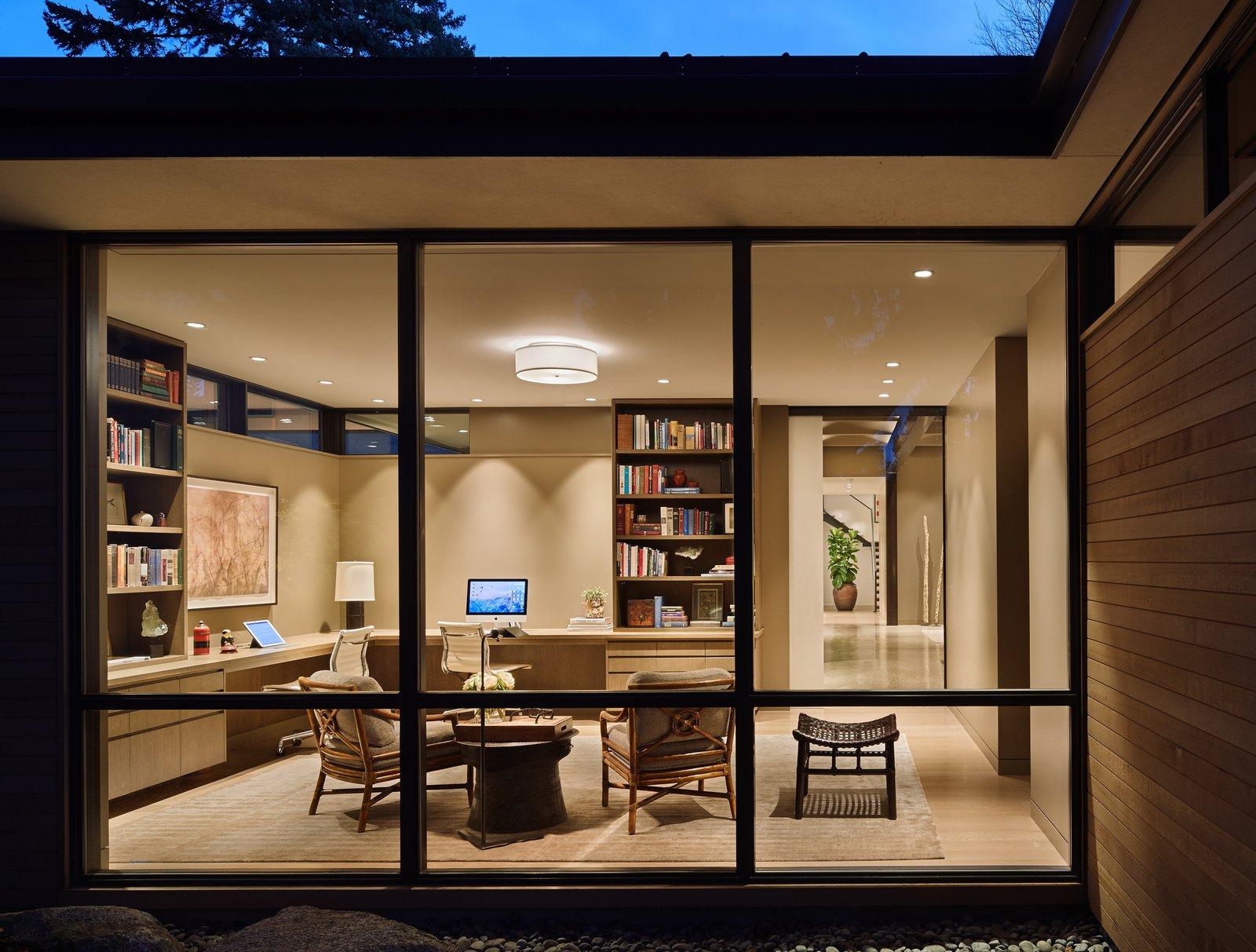 Office, Study Room Type, Chair, Desk, and Medium Hardwood Floor Den  Best Photos from Union Bay Residence