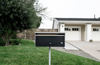 A modern mailbox in the front landscape provides character that emphasizes the overall minimal aesthetic.